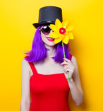 Girl with purple color hair and Pinwheel toy Royalty Free Stock Image