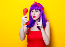 Girl with purple color hair and red handset Royalty Free Stock Photos