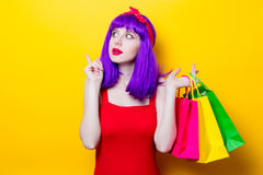 Girl with purple color hair and shopping bags Stock Photography