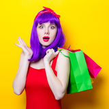 Girl with purple color hair and shopping bags Stock Image