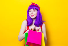 Girl with purple color hair and shopping bags Royalty Free Stock Photos