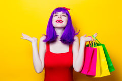 Girl with purple color hair and shopping bags Royalty Free Stock Images