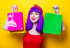 Girl with purple color hair and shopping bags Royalty Free Stock Image