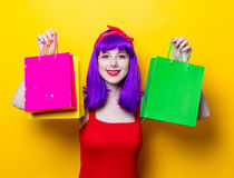 Girl with purple color hair and shopping bags Royalty Free Stock Photo