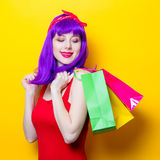 Girl with purple color hair and shopping bags Stock Photos