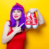 Girl with purple color hair and sneakers Stock Photo