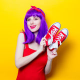 Girl with purple color hair and sneakers Royalty Free Stock Image