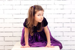 Girl in a purple dress Stock Photo
