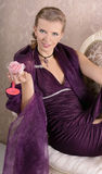 Girl. The girl in the purple dress with a glass in hand Stock Image