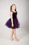 Girl in a purple dress Royalty Free Stock Photo