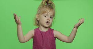 Girl in purple dress tells something with expression. Blonde child. Chroma Key. Positive girl talking with expression in purple dress. Happy four years old girl stock images
