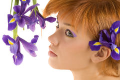 Girl with purple flower Stock Photos