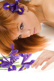 Girl with purple flower stock image