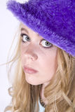Girl with purple hat Stock Image