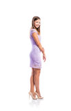 Girl in purple lace dress, heels, studio shot, isolated Royalty Free Stock Photography