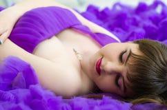 Girl in purple long dress Stock Photography