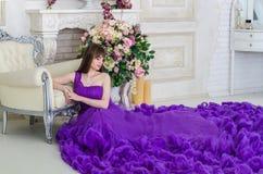 Girl in purple long dress Royalty Free Stock Image