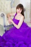 Girl in purple long dress Stock Photos