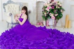 Girl in purple long dress Stock Image
