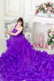 Girl in purple long dress Royalty Free Stock Photo
