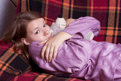 The girl in purple pajamas. In the room Royalty Free Stock Photography