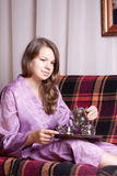 The girl in purple pajamas Stock Photos
