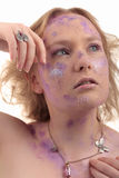 Girl purple powder make-up jewelry Stock Photography