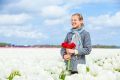 Girl in the purple tulips field Royalty Free Stock Image