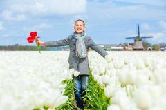 Girl in the purple tulips field Royalty Free Stock Photography