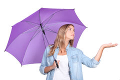 Girl with a purple umbrella Stock Photo