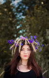 Girl in purple wreath. Photo of girl in purple floral wreaths on bokeh background Stock Photography