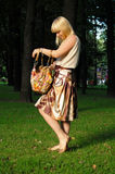 Girl with the purse Royalty Free Stock Image