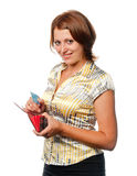 Girl with a purse and credit card in hands Royalty Free Stock Photos