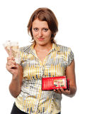 Girl with a purse and money in hands Royalty Free Stock Photography
