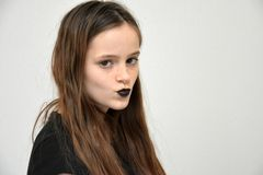 Girl purses her lips and blows a kiss Royalty Free Stock Photos