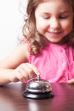 Girl push on the bell Royalty Free Stock Images