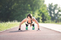 Girl push-up outdoors track. Girl push-up, outdoors, track royalty free stock photos