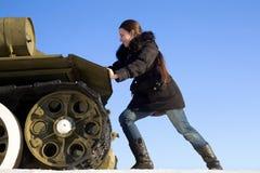 The girl pushes the tank. Joke Stock Photos