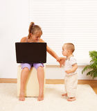 Girl pushing away her brother Stock Images