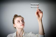 Girl pushing the button. Login and password Royalty Free Stock Images