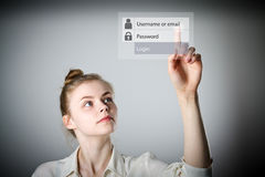 Girl pushing the button. Login and password Stock Images