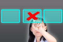 Girl pushing cross symbol  button with technology background Stock Photography