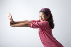 Girl pushing imaginary wall Royalty Free Stock Images