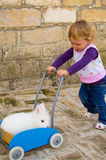 Girl pushing rabbit in the cart Stock Image