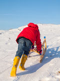 Girl pushing a sledge Royalty Free Stock Photo