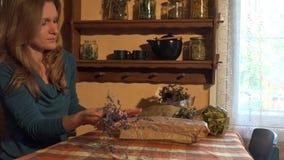 Girl put dried heath in pack. Herbal prepare for healing tea. 4K stock video footage