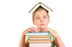 Girl put hands on pile books. Little girl with book on head put hands on pile books Stock Image