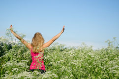 Girl put hands to sky tall caraway grass summer Royalty Free Stock Images