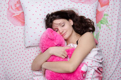 The girl put her in a dream bear Royalty Free Stock Image