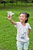 The girl put the plane. Chinese girl put paper plane Royalty Free Stock Photos